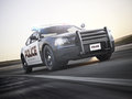 Police car running with lights and sirens on a street with motion blur Royalty Free Stock Photo
