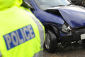 Police at a car smash officer the scene of collision selective focus good depth sharp focus vehicle as backdrop with out of focus Stock Photography