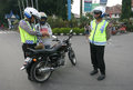 Police catch traffic violators in the city of solo central java indonesia Royalty Free Stock Images