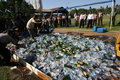 Police destroy illegal liquor seized in a raid in the city of solo central java indonesia Stock Photo