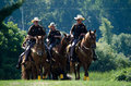 Police on duty ride horseback to monitor a large event during the jackson michigan civil war muster Royalty Free Stock Images