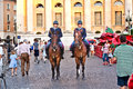 Police on horses are watching verona italy august and helping the spectators entering the arena di verona for a masterpiece of Royalty Free Stock Photos