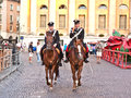 Police on horses are watching verona italy august using the mobile and and helping the spectators entering the arena august Royalty Free Stock Photography