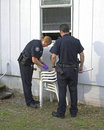 Police investigating burglary Royalty Free Stock Image