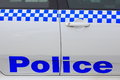 Police lettering on car close up of blue white door of australian Royalty Free Stock Image
