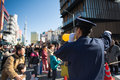 Police man conducting thousand of people to the the asakusa kann tokyo japan january kannon temple with sky tree tower in Stock Images