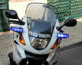 Police motorcycle in lisbon portugal detail of a with flashing blue lights turned on Royalty Free Stock Image