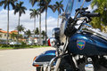 Police motorcycle in palm beach florida usa march close up of with houses and palms the background is considered by Royalty Free Stock Photo
