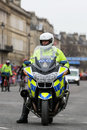 Police motorcyle officer uk bath march a motorcycle from avon and somerset waits to escort the runners at the bath half marathon Royalty Free Stock Images