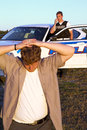 Police officer arrests criminal focus police young caucasian male as Royalty Free Stock Photos