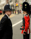 Police officer and british army soldier at thatcher funeral a sergeant from the guards a pc in the metropolitan line the route of Royalty Free Stock Photography