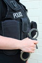 Police officer with handcuffs british rigid Stock Image