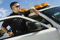 Police Officer Leaning On Patrol Car Royalty Free Stock Photo