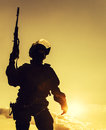 Police officer with weapons silhouette of at sunset Royalty Free Stock Images