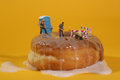 Police officers in conceptual food imagery with doughnuts miniature Stock Image