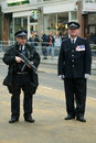 Police officers line funeral route an inspector and a specialist firearms officer from the metropolitan stand on fleet street as Royalty Free Stock Photo