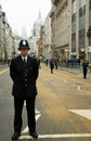Police officers line funeral route a metropolitan officer stands on fleet street as others the of the cortege for baroness Royalty Free Stock Photography