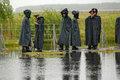 Police officers stand in cordon in rainy weather Royalty Free Stock Photo