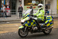 Police outrider at baroness thatcher s funeral a metropolitan officer on a motorbike leads a cavalcade of vips to Royalty Free Stock Images