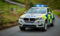 Police persuit a car speeds to an emergency Royalty Free Stock Images