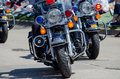 Police presence on motorcycles cruise through town Royalty Free Stock Photos