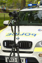 Police at the scene of a traffic incident csi camera an Stock Image