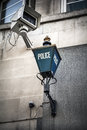 Police sign and surveillance camera Royalty Free Stock Photo
