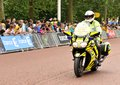 Police at the tour de france london uk – july surveys area of mall who hosted third stage of Stock Image