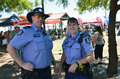 Police two friendly western australian offices as they patrol the port hedland market a cruise ship was in for the day in march Royalty Free Stock Image
