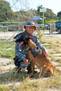 Policeman and canine philippines march a member of the philippine national police division his dog take a break during the annual Royalty Free Stock Photos