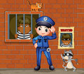 A policeman in front of a jail with two cats Royalty Free Stock Photo