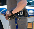 Policeman with hand on gun belt Royalty Free Stock Photo