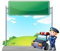 A policeman with his patrol car near the signage illustration of Stock Photography