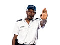 Policeman making a stop gesture Stock Images