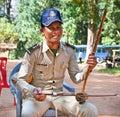Policeman playing instrument Thro khmer, Cambodia. Royalty Free Stock Photo
