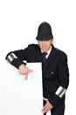 Policeman pointing to advertising board Stock Photography