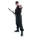 Policeman pointing wearing black uniform in ordering manner Royalty Free Stock Image