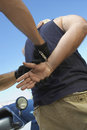 Policeman s hands arresting criminal cropped image of Royalty Free Stock Photos