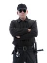 Policeman security guard wearing black uniform glasses standing confidently folded arms shot white Stock Photography