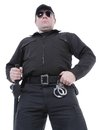 Policeman wearing black uniform and glasses standing confidently Royalty Free Stock Images