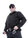 Policeman wearing black uniform and glasses standing confidently Stock Photos