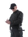 Policeman wearing black uniform glasses taking notes shot white Stock Image