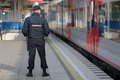 Policemen sochi russia mar the police officer patrols the railway station hosta increased security measures because of the olympic Stock Photo