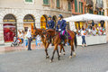 Policenmen with horses watch verona italy august the scenery at the entrance of the arena late afternoon on august verona italy Royalty Free Stock Image