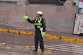 Policewoman stands on the street in the center of the city on may in cusco peru Royalty Free Stock Photo