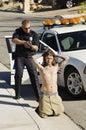 Policier arresting young man Images libres de droits