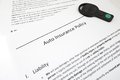 Policy and key closeup of auto insurance with car Stock Photos