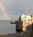 Polignano rainbow over the adriatic at a mare Stock Image