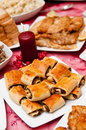 Polish christmas table traditionally set french breads with poppy seed in the foreground Stock Photo
