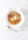 Polish Easter Soup made with Ray Flour, Egg and sausage Royalty Free Stock Photo